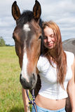 Horse and young woman Royalty Free Stock Image
