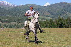 On horseback across the steppe Stock Image
