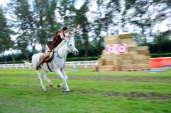 Horseback Archery Competition Stock Photo