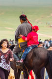 Horseback boy & man on steppe, Nadaam horse race Stock Photography