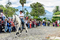 Horseback cowboy rides in village, Guatemala Stock Photo