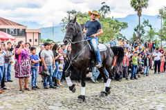 Horseback cowboy rides in village, Guatemala Royalty Free Stock Photo