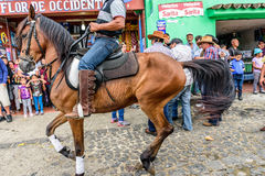 Horseback cowboys ride in village, Guatemala Stock Images