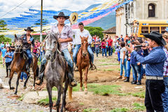 Horseback cowboys in village, Guatemala Stock Photo