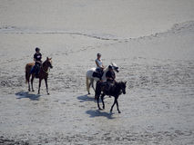 On horseback crossing the tidal bay at Mont Saint Michel, France Stock Photography