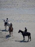 On horseback crossing the tidal bay at Mont Saint Michel, France Stock Photos