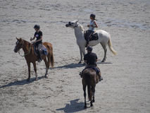 On horseback crossing the tidal bay at Mont Saint Michel, France Royalty Free Stock Photo