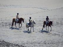 On horseback crossing the tidal bay at Mont Saint Michel, France Stock Photo