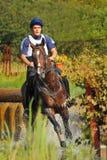 Horseback jumping in splashes water Royalty Free Stock Photos