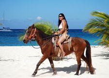 Horseback In Mexico. The girl riding on a horseback on Cozumel island beach, Mexico stock images