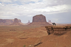Horseback in Monument Valley. A navajo woman on horseback in a scenic monument valley landscape Royalty Free Stock Photos