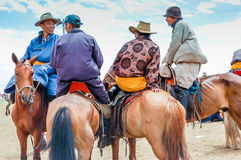 Horseback riders in deel, Nadaam horse race, Mongolia. Khui Doloon Khudag, Mongolia - July 12, 2010: Horseback locals at Nadaam (Mongolia's most important Royalty Free Stock Image