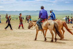 Horseback riders, Nadaam horse race, Mongolia. Khui Doloon Khudag, Mongolia - July 12, 2010: Horseback riders at Nadaam (Mongolia's most important festival whose Stock Photos