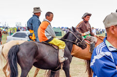 Horseback riders, Nadaam horse race, Mongolia. Khui Doloon Khudag, Mongolia - July 12, 2010: Horseback riders at Nadaam (Mongolia's most important festival whose Royalty Free Stock Photo