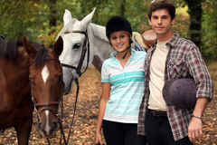 Horseback riders. With their horses stock photos