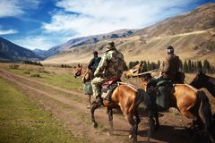 Horseback Riding. In the Kazkahstan mountain royalty free stock images