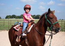 Horseback Riding. A little girls poses on her horse before her horseback riding lesson Stock Images