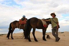 Horseback riding in desert Stock Photo
