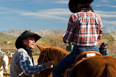 Cowboys at Roundup. Vacationers from a dude guest ranch go for a horseback ride in the Arizona desert Royalty Free Stock Photos