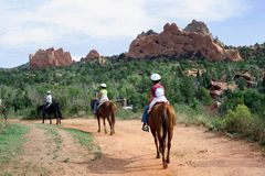 Horseback Riding in the Garden of the Gods. Horseback riders in the Garden of the Gods, a popular scenic destination in Colorado Springs, Colorado royalty free stock photos