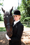 Horseback riding girl Stock Images