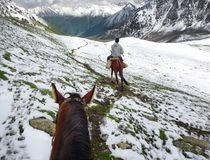 Horse riding in Kyrgyzstan, Tien Shan royalty free stock photography