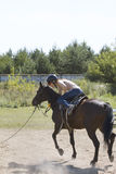 Horseback riding lessons - accident with horse, fall of rider Stock Image