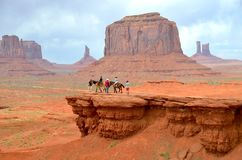 Horseback Riding at Monument Valley in AZ,USA. MONUMENT VALLEY, AZ - MAY 21: Horseback Riding at Monument Valley on May 21, 2015 Arizona,USA. Thousands of people Stock Images