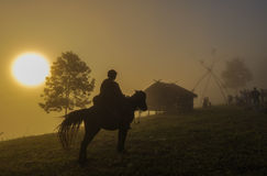 Horseback riding. On the mountain and fog in the morning Royalty Free Stock Photography