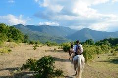 Horseback riding in mountains royalty free stock image