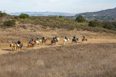 Horseback Riding in Santa Monica Mountains. A group of equestrians take advantage of the many trails in the Santa Monica Mountains of Southern California Royalty Free Stock Image