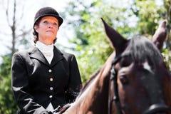 Horseback riding senior woman Stock Photo