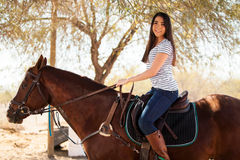 Horseback riding on a sunny day Stock Photos