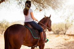 Horseback riding on a sunny day Stock Photography
