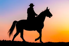 Horseback riding in the sunset Stock Photo