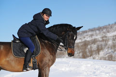 Horseback riding in winter Stock Images
