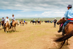 Horseback spectators on steppe, Nadaam horse race Stock Photo