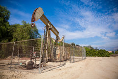Horsehead pumpjack with a blue sky background Royalty Free Stock Images