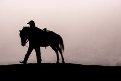 HorseMan. And his horse heading home Royalty Free Stock Image