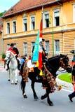 Horseman holding flag during Brasov Juni parade Stock Photos