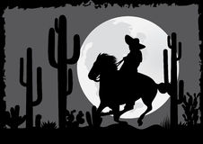 Horseman rides in the desert Stock Image