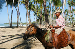 Horseman riding on the beach of Bonita at Las Terrenas Stock Images