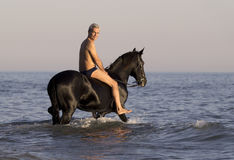 Horseman in the sea Royalty Free Stock Images