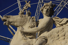 Horseman statue on the Place de la Concorde with ferris wheel, Paris, France Stock Photography