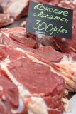 Horsemeat. raw meat on the market. Together with the price list Royalty Free Stock Images