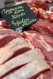 Horsemeat. raw meat on the market. Together with the price list Stock Images