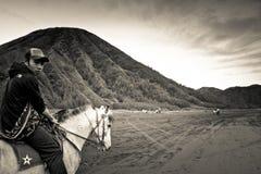 A horsemen of Bromo volcano, Bromo, Indonesia. The horsemen of Bromo volcano, Bromo, Indonesia Royalty Free Stock Image