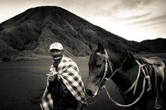 A horsemen of Bromo volcano, Bromo, Indonesia Royalty Free Stock Photos