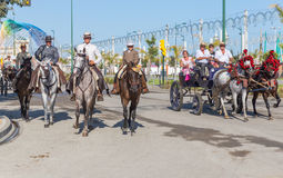 Horsemen and carriages. MALAGA, SPAIN - AUGUST 21, 2014: Horsemen and carriages take a ride at Malaga August Fair Royalty Free Stock Image