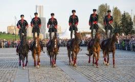 Horsemen Cavalry Escort of the Presidential Regiment perform trick riding Stock Photos